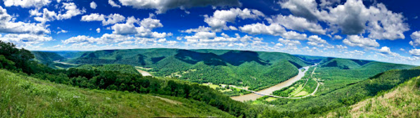 view of pennsylvania mountains with river and bright blue sky