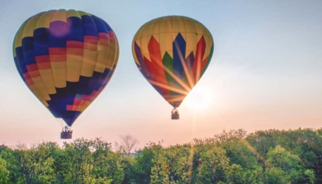 two hot air balloons, very colorful