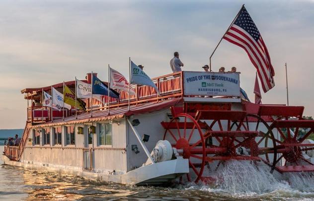 paddlewheel river boat flying American Flag