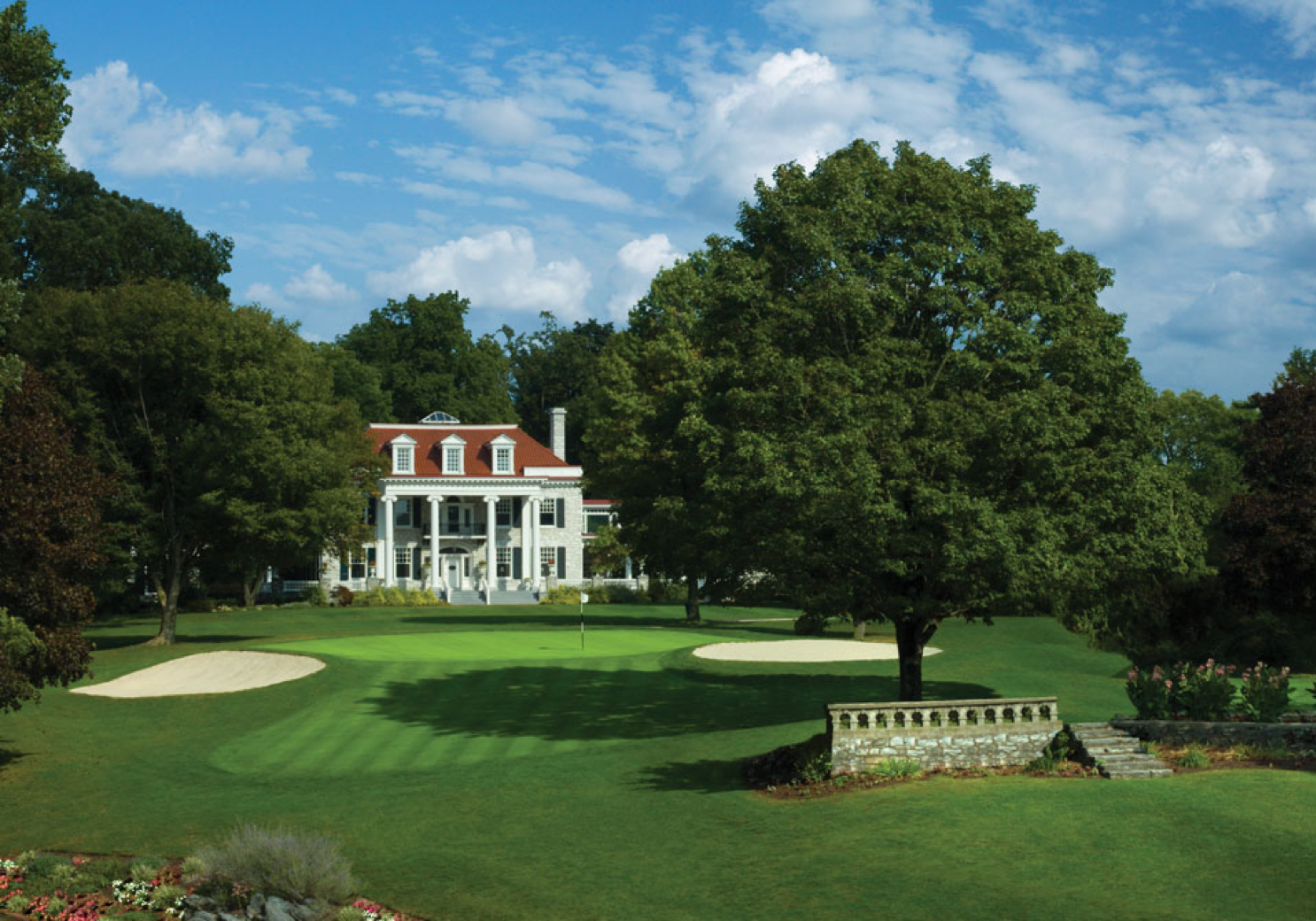 """Milton Hershey's """"High Point"""" mansion with golf course in foreground"""