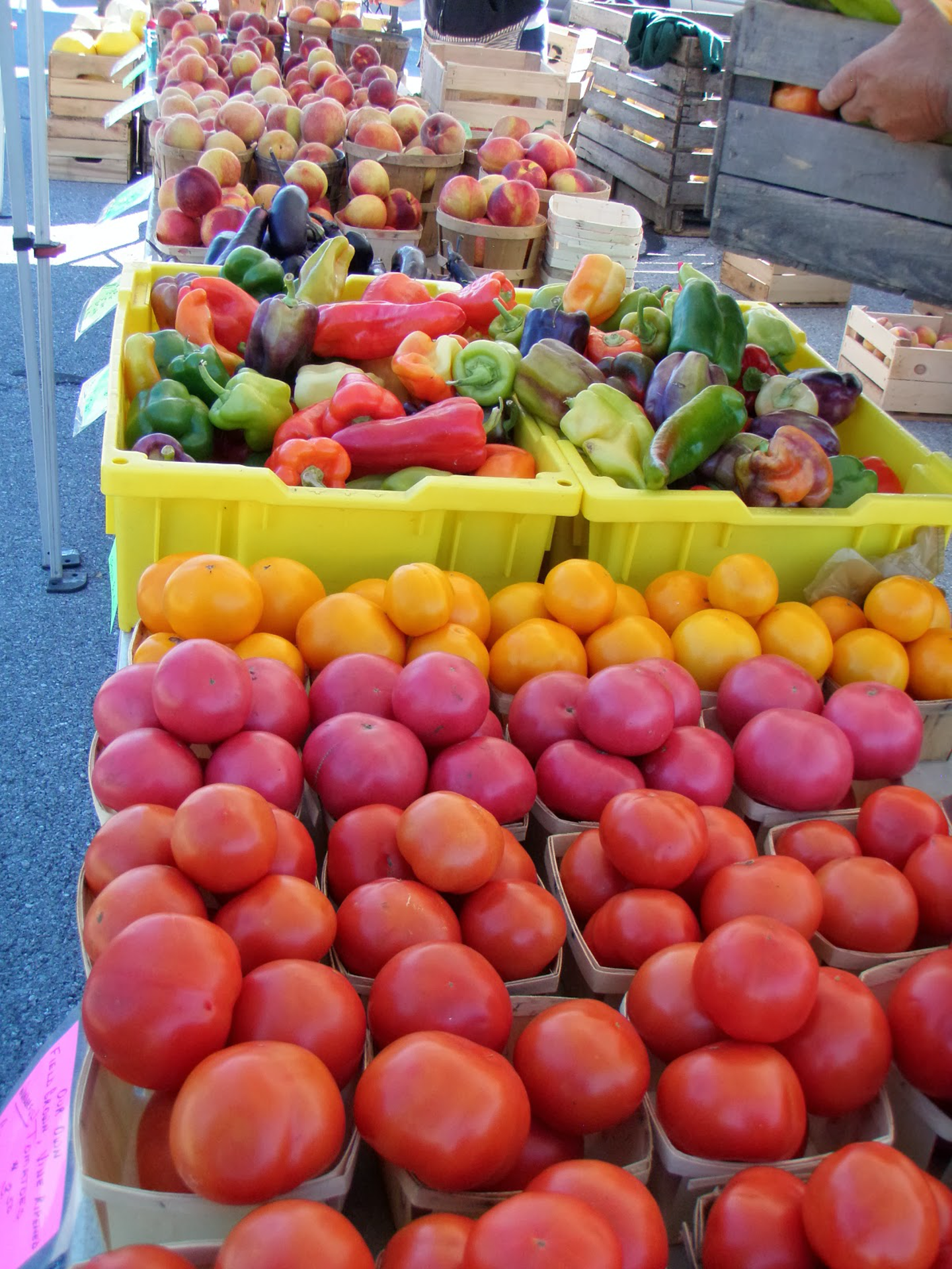 bins of fruits and vegetables at farmer's market
