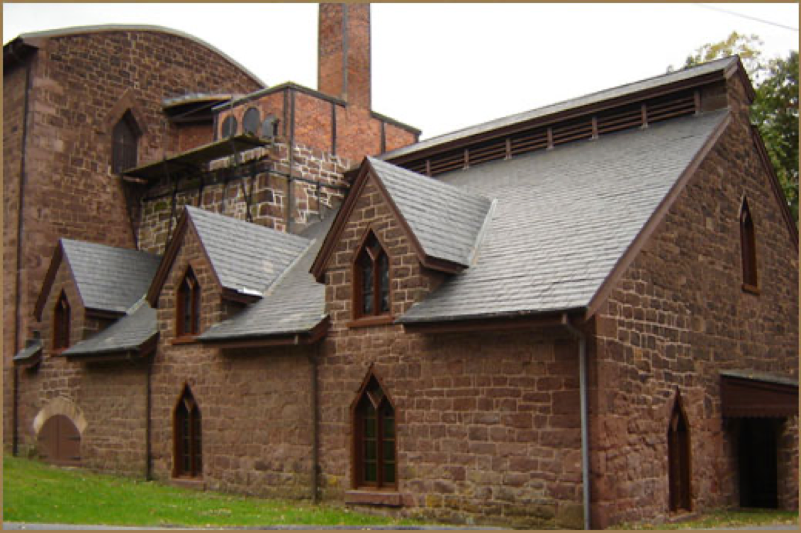 Exterior of Cornwall Iron Furnace, a brownstone building