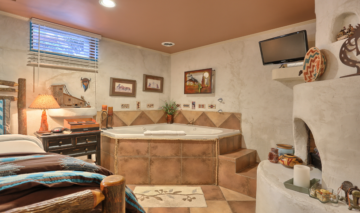 Great Southwest Room showing Two Person Jacuzzi and Fireplace and Bed