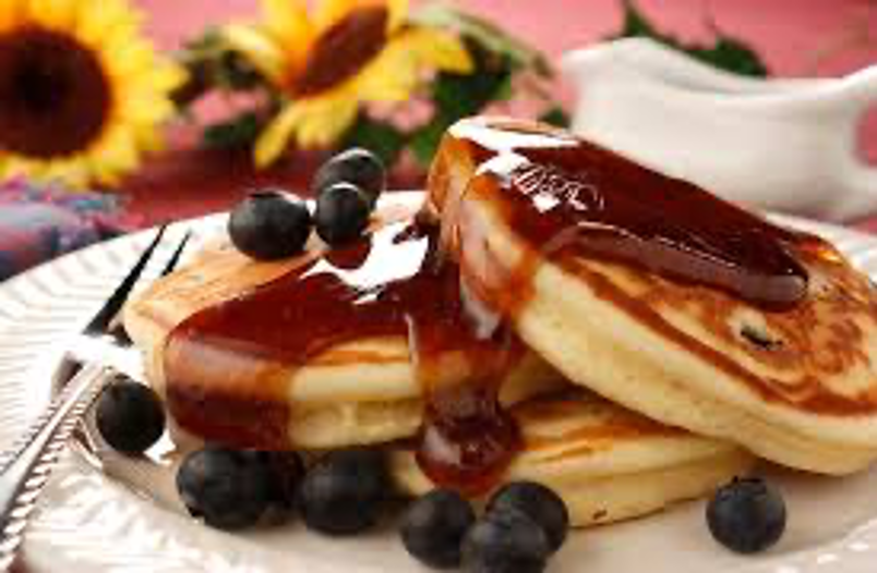 Breakfast pancakes with blueberries and syrup