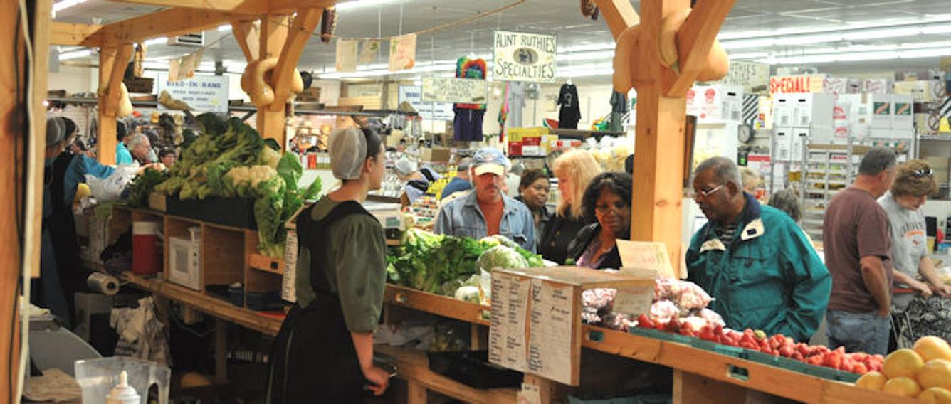 Inside Broad Street Market, Harrisburg showing vendor's and crowds.