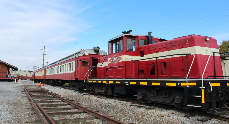 M&H Railroad diesel locomotive pulling antique passenger cars