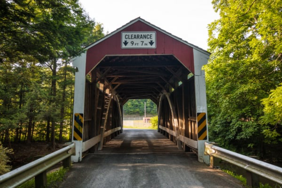 Tall, red covered bridge, showing the inside of the bridge structure.
