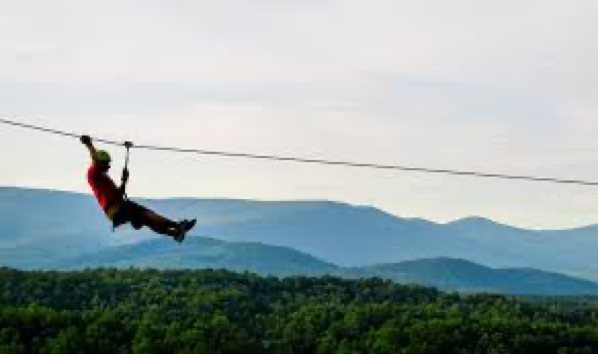 zip line with mountains in background