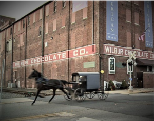Amish buggy passing Wilbur Chocolate Factory