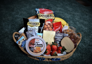 Basket of crackers, cheeses and fruits