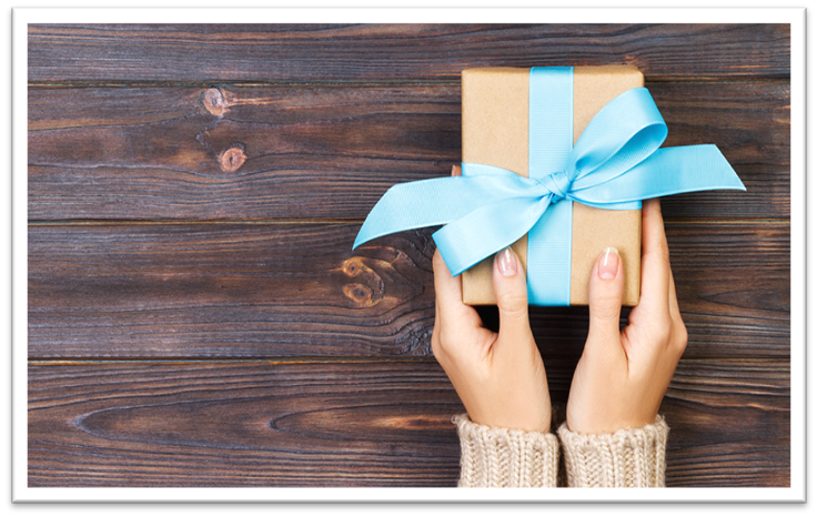 Lady presenting a wrapped gift