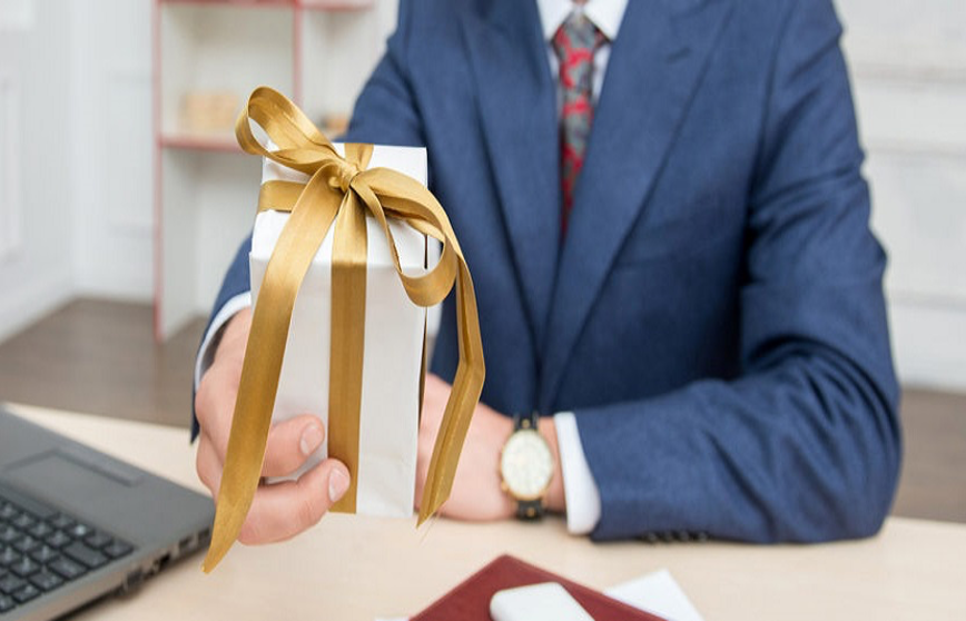 Man presenting wrapped gift