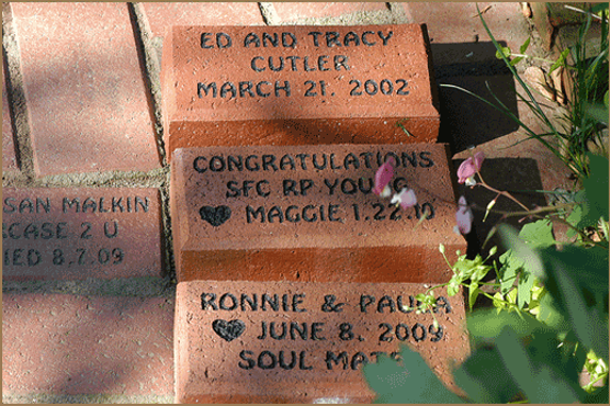 Series of engraved bricks showing guest's anniversaries