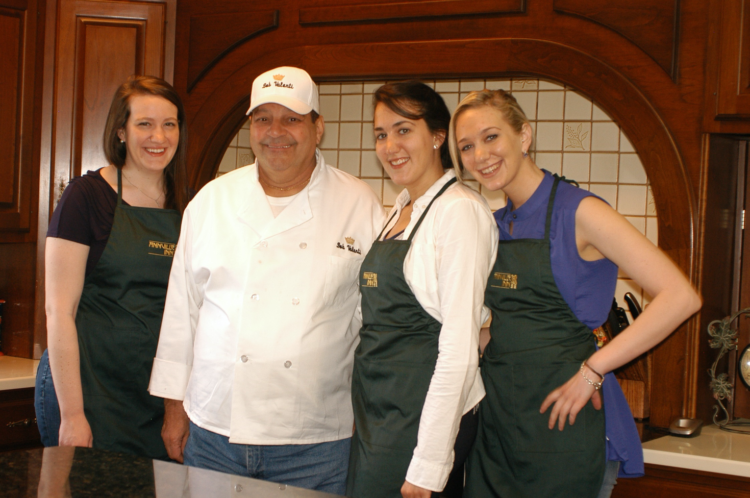Chef posing with three students in Annville In kitchen
