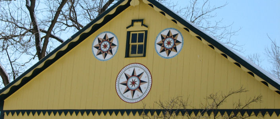 "yellow barn with three Amish ""Hex Symbols"""