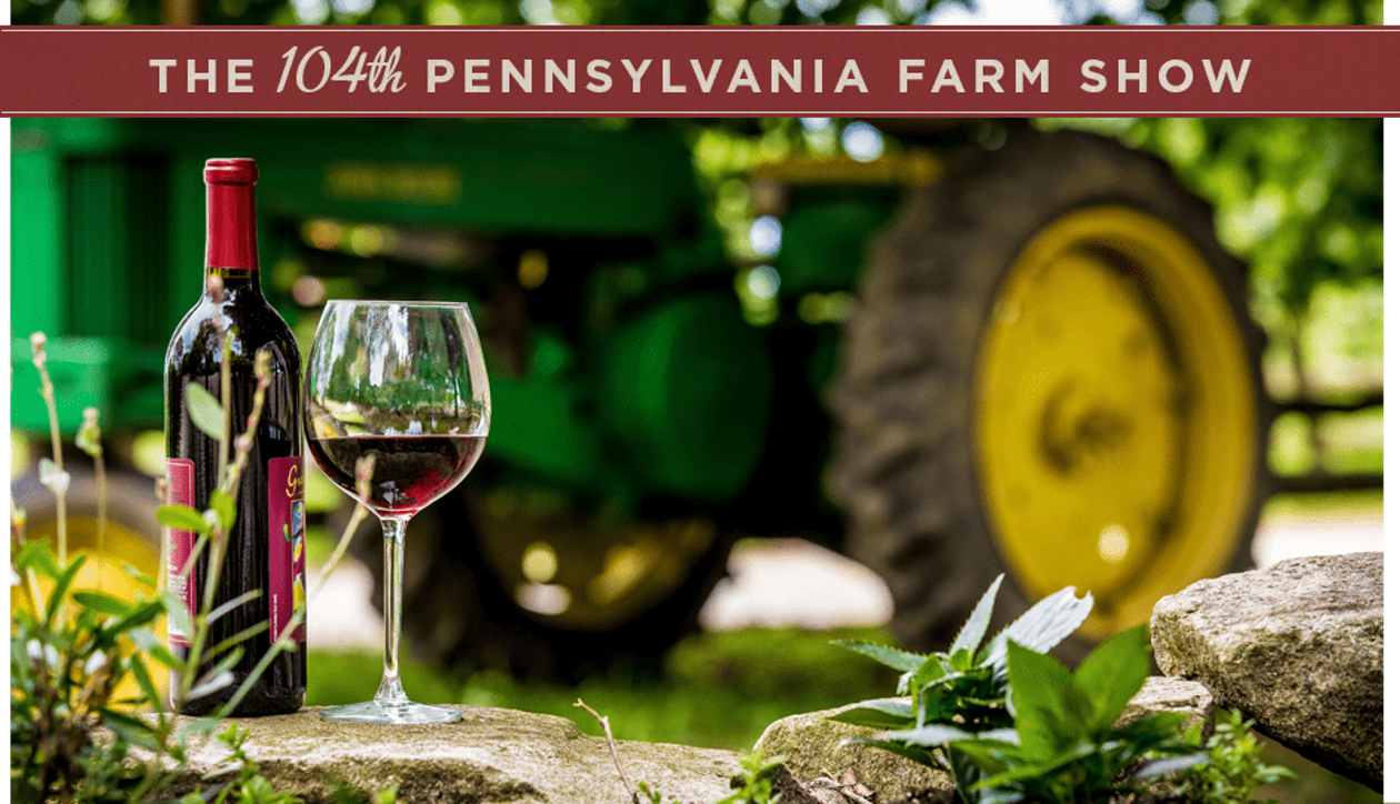 104th Penna Farm Show poster showing a bottle and glass of wine