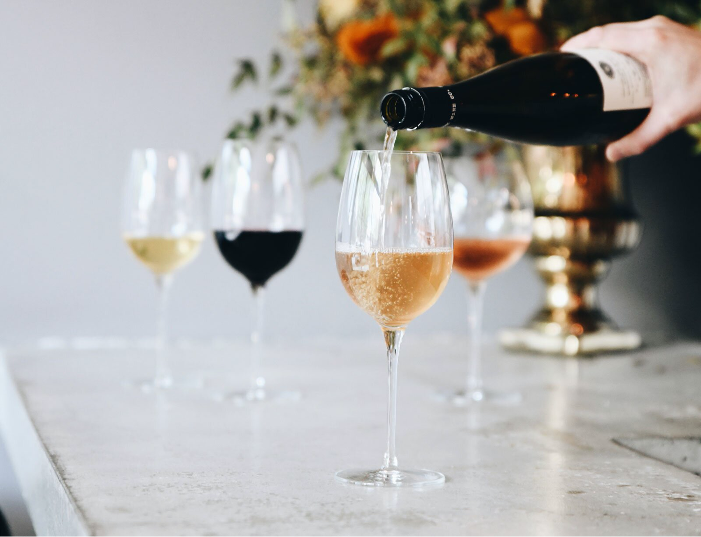 Pouring wines into four goblets