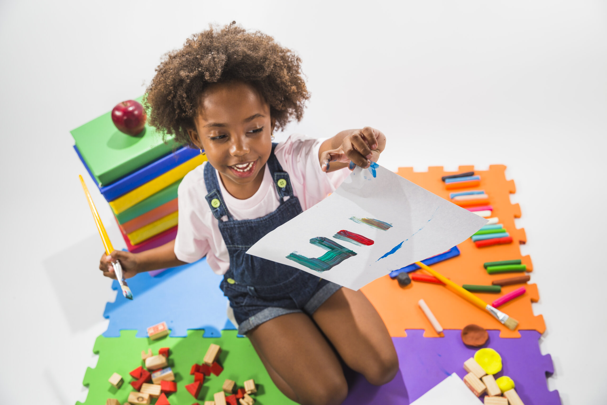 girl-with-painted-paper-play-mat-studio