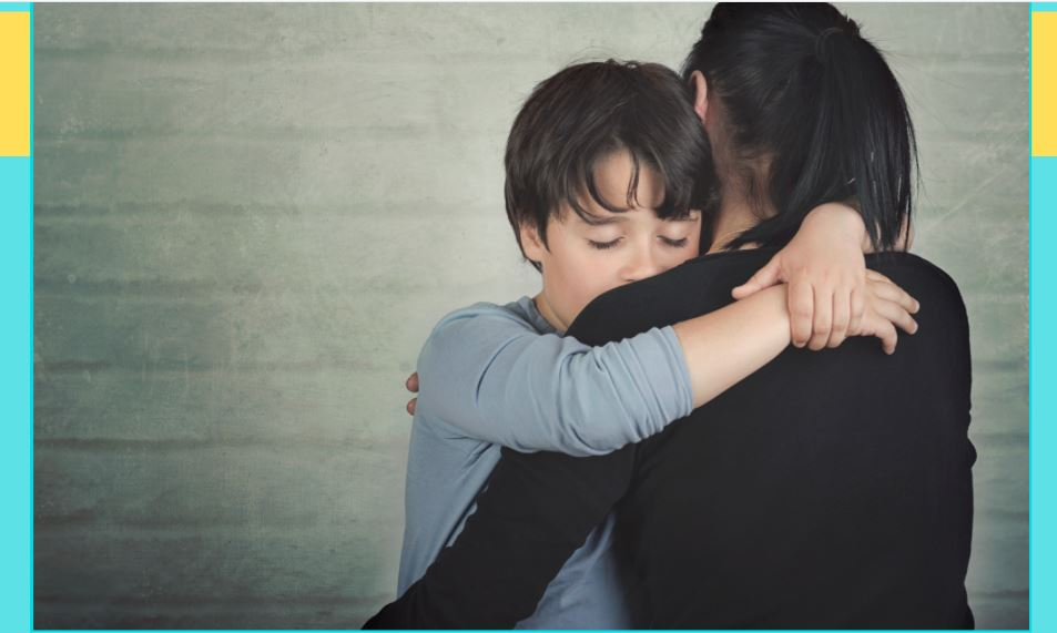 Boy and mom hugging, looking sad or tired