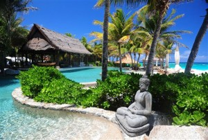 """A statue decorates the pool area of Richard Branson's property on Necker Island in the British Virgin Islands, Friday, May 17, 2013.  Political and business leaders gathered here Friday to back an initiative aimed at expanding protection for the Caribbean's imperiled coasts and waters. Delegations from the participating governments signed a communique pledging to establish a framework for a regional approach to coastal conservation, including """"increasing considerably the number of marine protected areas."""" They also said they recognized an urgent need to protect sharks and rays, and vowed a """"dramatic acceleration in the transition from fossil fuels to alternative energy sources over the next five years."""" (AP Photo/Todd VanSickle)"""