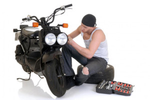 man-working-on-motorcycle