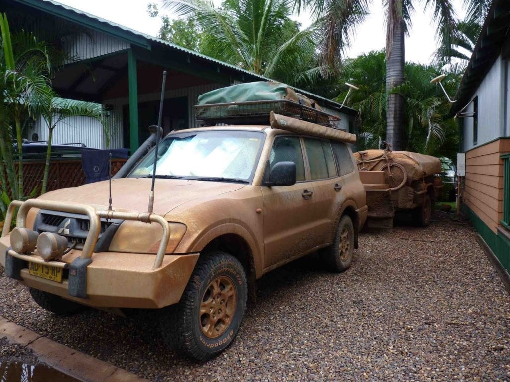 Off-Road Race Vehicle. Pajero and camper covered in thick Gibb River Road mud