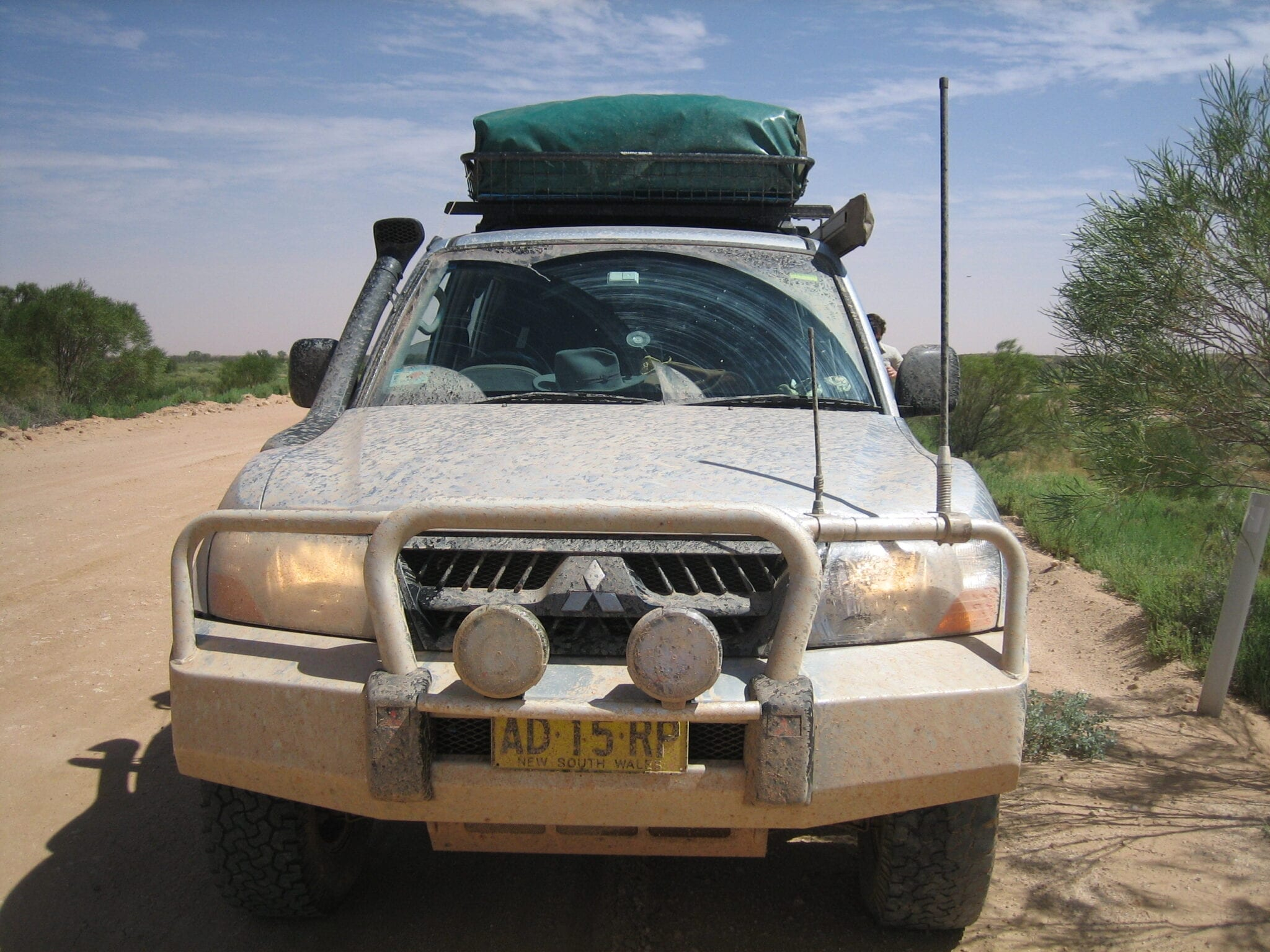 NP Pajero covered in salty muddy water on the Oodnadatta Track