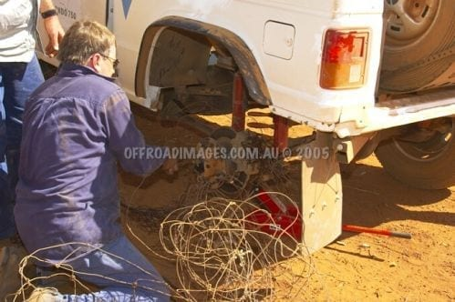 Pajero ute at Condo 750 off road event - tangled in a fence