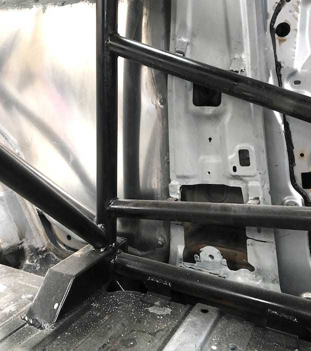 Behind the passengers seat. Details of how the roll cage attaches to the floor pan.