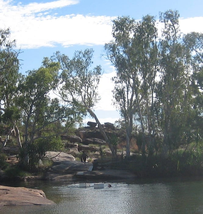 Floating their gear across the Manning River in styrofoam boxes. Mount Barnett Campground.