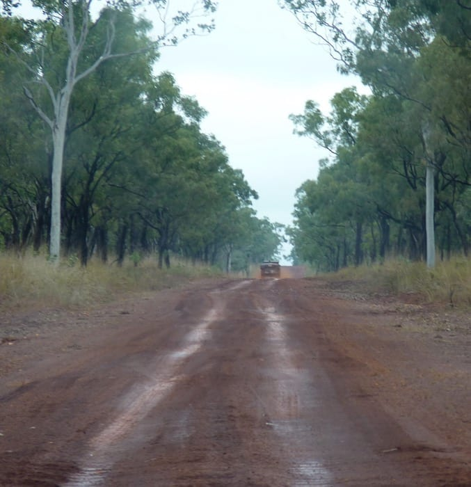 Driving out of Drysdale River Station along Kalumburu Road. Muddy Gibb River Road.