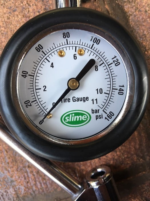 Close-up of the slime tyre pressure gauge. Gauge reads up to 160psi. Review: ARB Compressor.