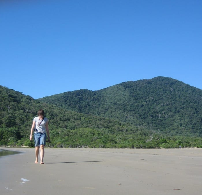 Charlie wandering along Finch's Bay beach with Mt Cook in the background. Cooktown.
