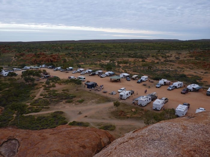 The campground filling at dusk. Devils Marbles campground.