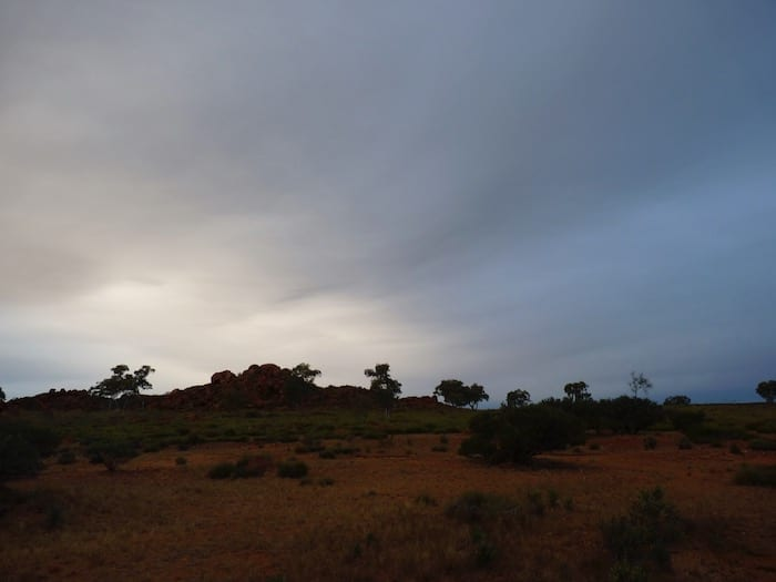 A cold, wet sky. Devils Marbles.