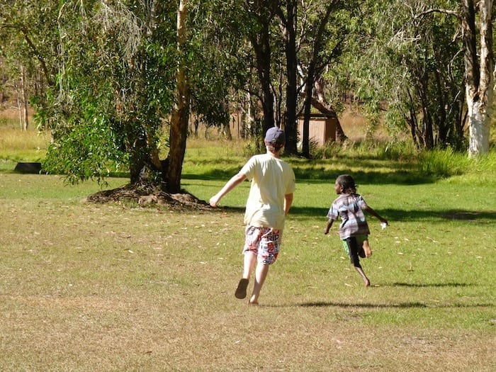 Young Desmond was about 7 years old and ran rings around Ben when they played Tip. Manyallaluk, Northern Territory.
