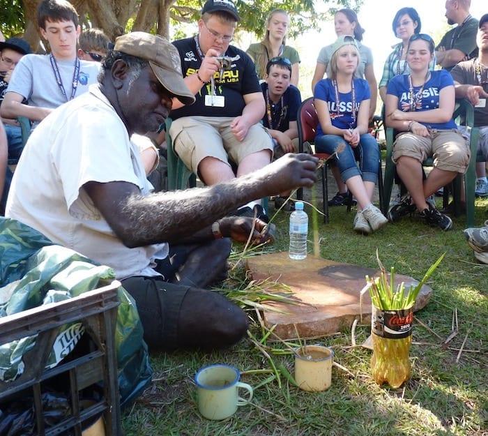 John Dewar preparing cane grass leaves to use as paintbrushes. Manyallaluk, Northern Territory.
