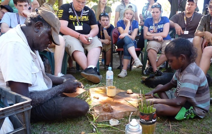 John and Desmond showing us how to paint using brushes fashioned from canegrass leaves and ochre collected from the surrounding countryside. Is harder than it looks. Was fascinating watching the quiet interaction between John and Desmond; very much the old dog and the young pup. Desmond's respect for John was very evident. Manyallaluk, Northern Territory.