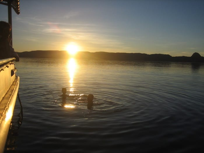 The kids swimming in the lake at sunset. Lake Argyle Cruises.