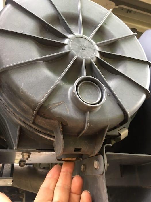 Drain valve on Isuzu NPS Air Cleaner Housing.