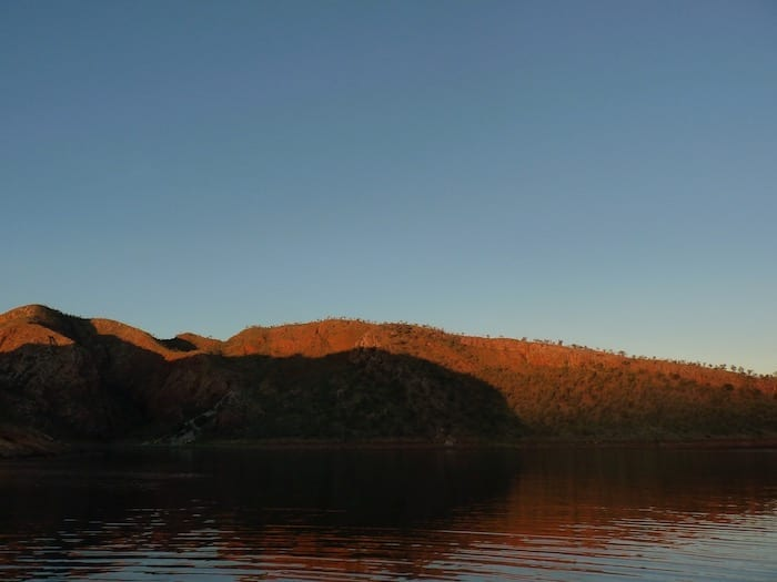Sun setting on the mountains. Lake Argyle Cruises.