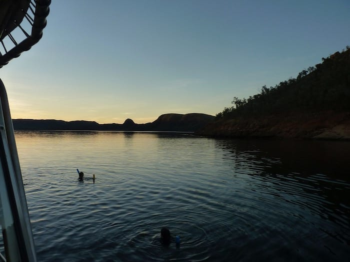 Floating on the lake at sunset. Lake Argyle Cruises.
