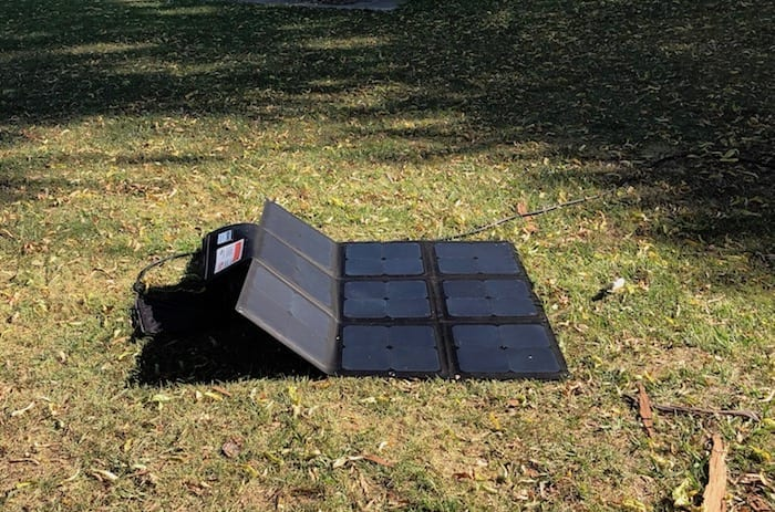 REDARC 115W SunPower Cell solar blanket, propped up with a thong.