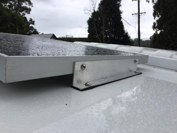 12V Solar Panel showing neoprene between bracket and top of storage box.