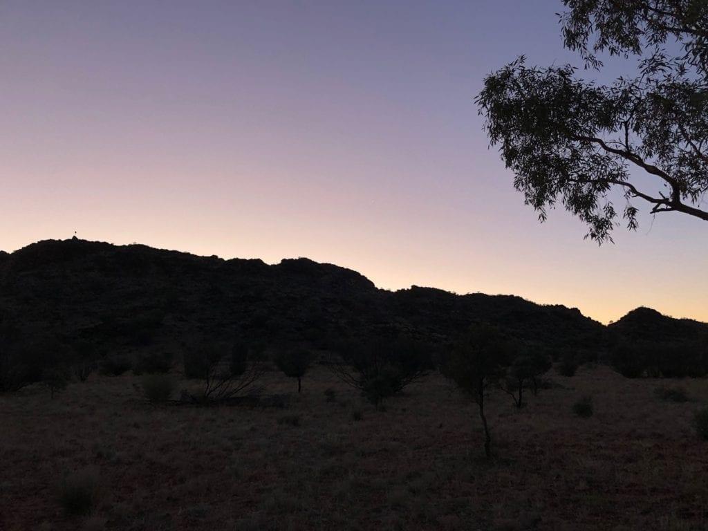 Sunset over an ancient volcanic range, Plenty Highway.