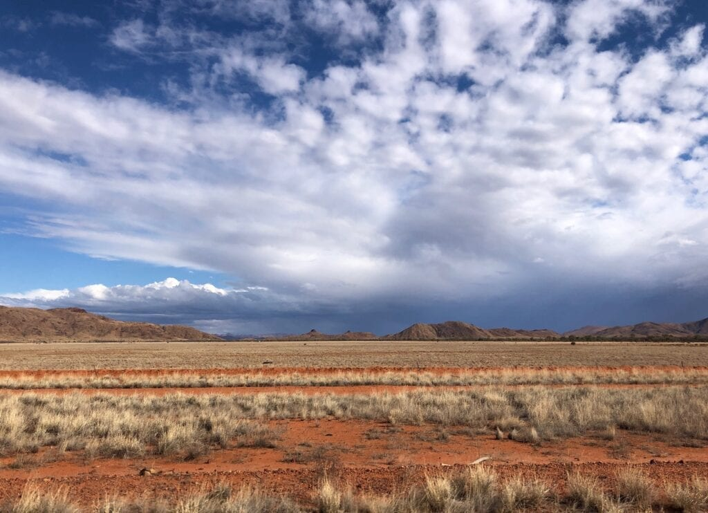 Rain clouds to the south-east of Tanami Road, over the MacDonnell Ranges.
