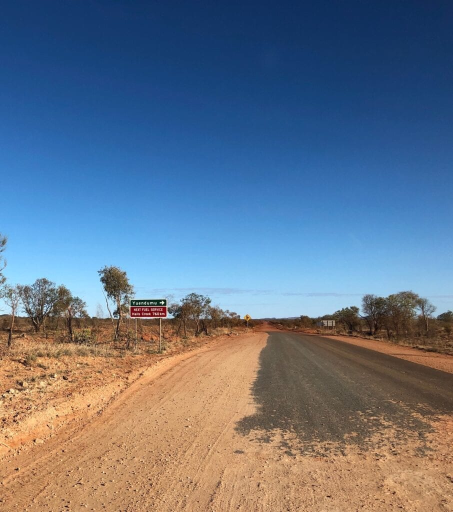 The sign to Yuendumu and a sign warning of the last fuel for 760km. Tanami Road.