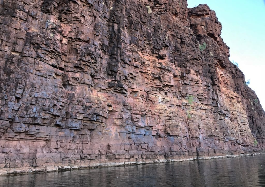 The gorge walls look like they've been meticulously built from blocks. Kayaking Carawine Gorge.