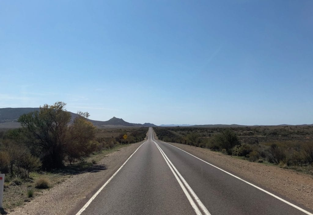 Approaching Hawker, north of Quorn SA. Old Ghan rail embankment just off the road to the right.