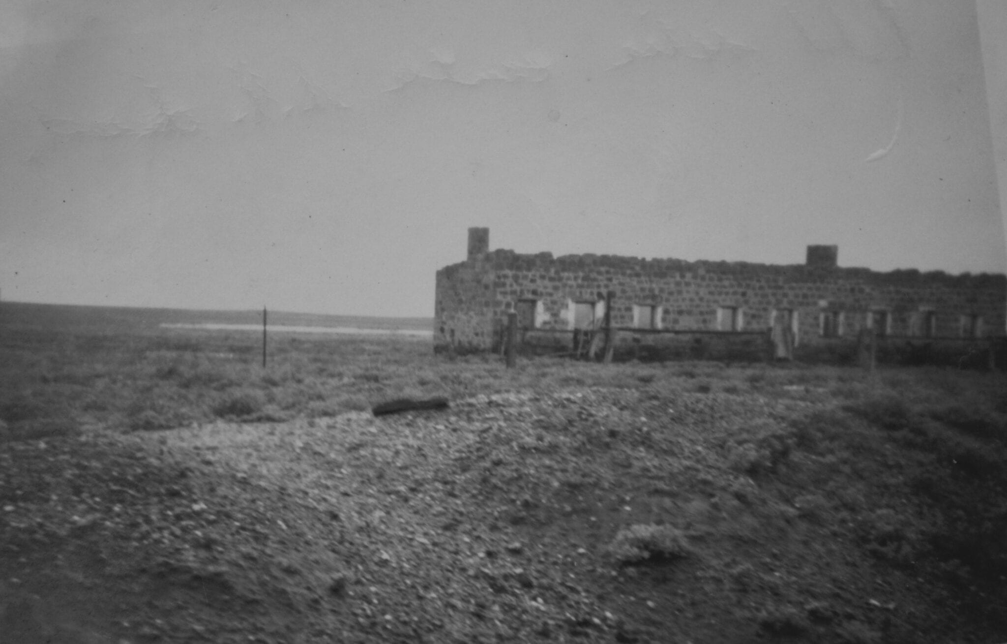 An abandoned rail building between Marree and Oodnadatta. Taken from the Old Ghan in 1950. Salt Lakes and Water.